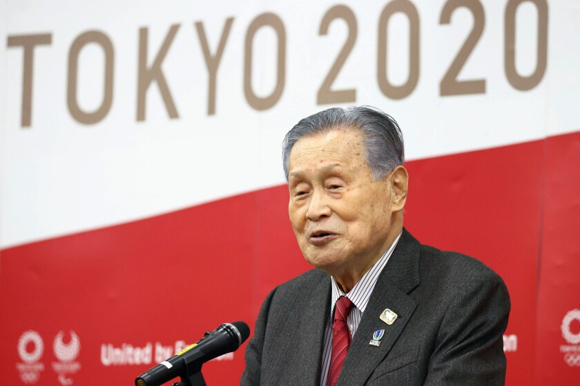 Tokyo 2020 Organizing Committee President Yoshiro Mori delivers a New Year's address in Tokyo Tuesday, Jan. 12, 2021. Mori tried on Tuesday to reassure the public that the postponed games will open in just over six months. (Kyodo News via AP)