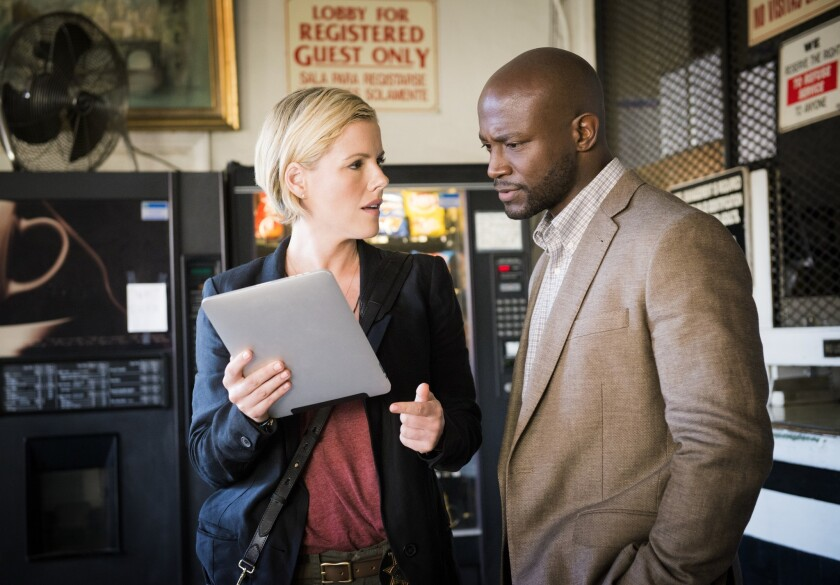 """Kathleen Robertson and Taye Diggs in TNT's new detective drama """"Murder In the First."""""""