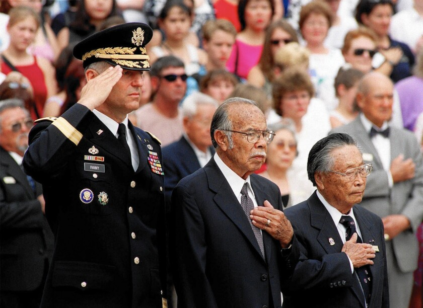 George Sakato, right, takes part in a wreath ceremony for Asian American, Native American and Pacific Islander Medal of Honor recipients in 2000. With him are Army Maj. Gen. Robert R. Ivany, left, and fellow recipient Rudolph Davila.