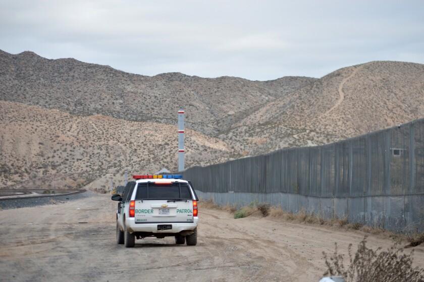 In this Jan. 4, 2016 photo, a U.S. Border Patrol agent patrols Sunland Park along the U.S.-Mexico border next to Ciudad Juarez.