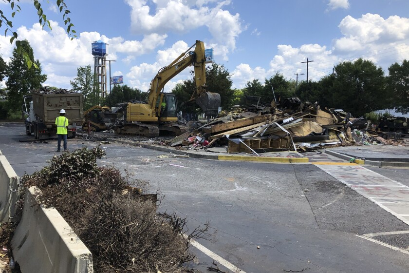 A Wendy's restaurant is demolished Tuesday in Atlanta.