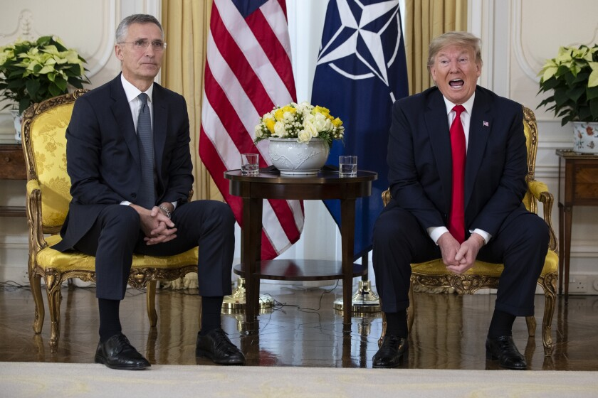 U.S. President Donald Trump speaks during a meeting with NATO Secretary General, Jens Stoltenberg at Winfield House in London, Tuesday, Dec. 3, 2019. US President Donald Trump will join other NATO heads of state at Buckingham Palace in London on Tuesday to mark the NATO Alliance's 70th birthday. (AP Photo/Evan Vucci)
