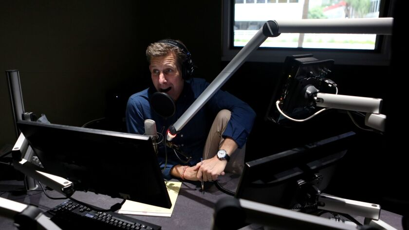 """Kai Ryssdal, host and senior editor of the program """"Marketplace,"""" prepares to record an episode of his """"Make Me Smart"""" podcast."""