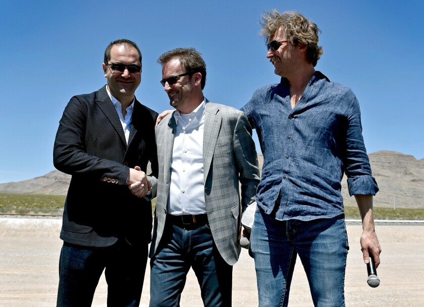 From left, Hyperloop One co-founder and Executive Chairman Shervin Pishevar, Chief Executive Rob Lloyd and co-founder and then-Chief Technology Officer Brogan BamBrogan at a company event in May.
