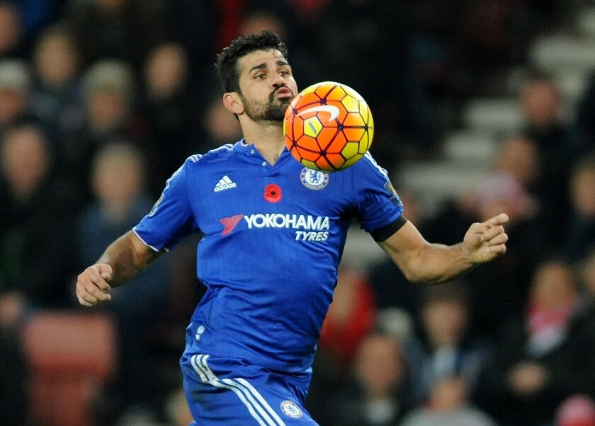 Chelsea's Diego Costa controls the ball during the English Premier League soccer match between Stoke City and Chelsea at the Britannia Stadium, Stoke on Trent, England, Saturday, Nov. 7, 2015. (AP Photo/Rui Vieira)