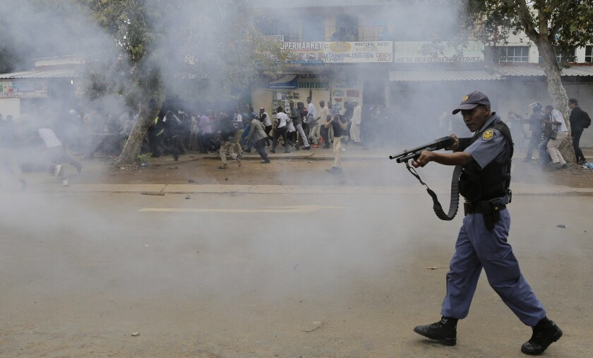 South African police fire rubber bullets to avert a confrontation between foreigners and anti-immigrant marchers in Pretoria on Feb. 24, 2017.