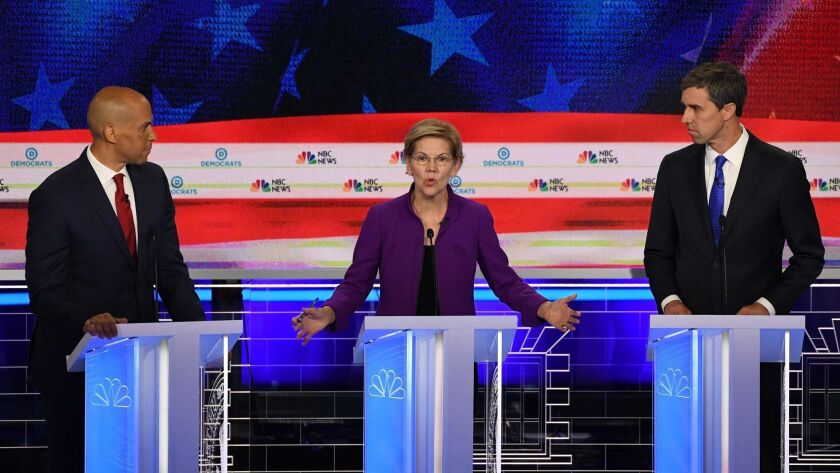Democratic presidential hopefuls Sen. Cory Booker of New Jersey, left, Sen. Elizabeth Warren of Massachusetts and former U.S Rep. Beto O'Rourke of Texas participate in the first Democratic primary debate of the 2020 presidential campaign season.