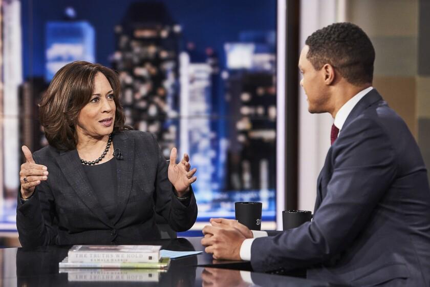CA Senator and Democratic presidential candidate Kamala Harris jokes with host Trevor Noah while on