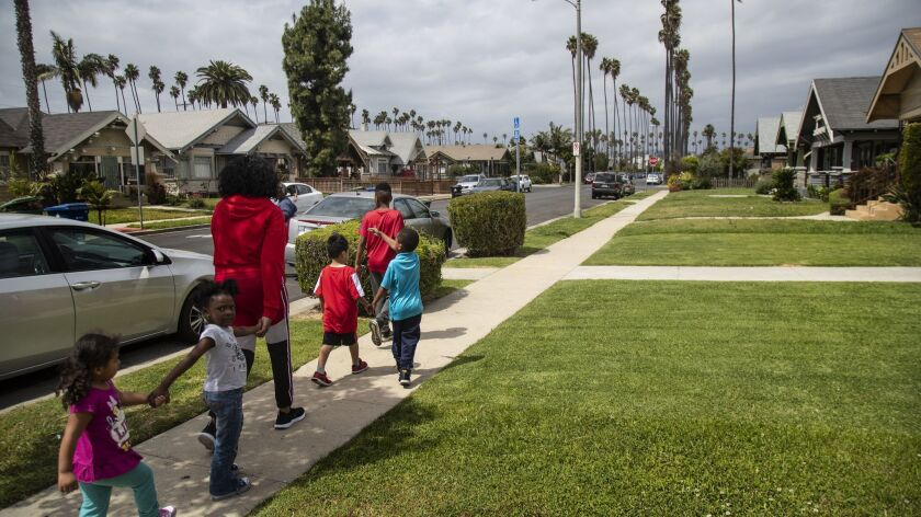 LOS ANGELES, CA - APRIL 16, 2019: Sandra Pruitt escorts kids she babysits to a nearby park from her