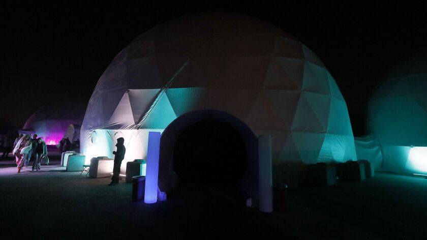 """Wisdome customers pay $25-and-up to enter an """"art park"""" with projected images, immersive film and other work. The opening features Android Jones, a """"digital painter"""" and Burning Man regular."""