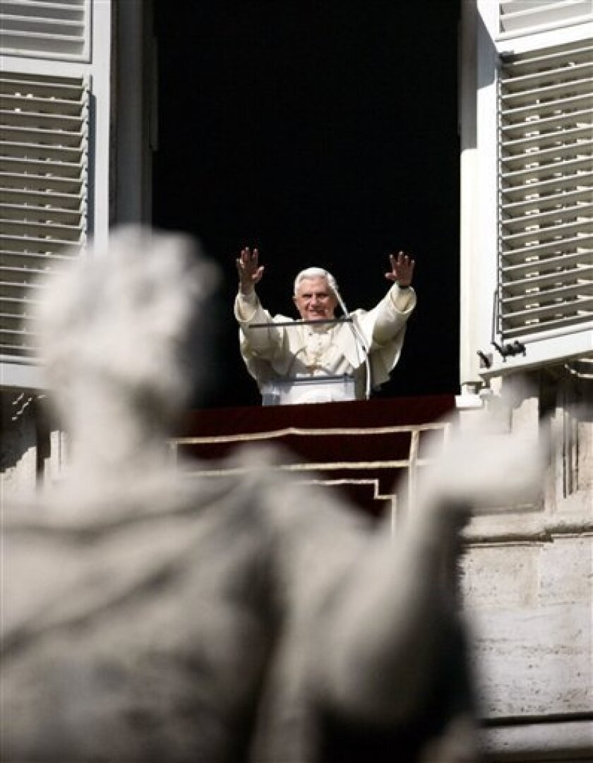 Pope Benedict XVI greets the faithful from his studio window overlooking St. Peter's square at the Vatican Monday, Dec. 8, 2008, during the Angelus prayer celebrating Dec. 8 as the Immaculate Conception of Mary national holiday. (AP Photo/Gregorio Borgia)