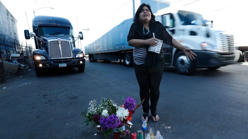 Aileen Kemper shows where a hit-and-run driver struck and killed her mother on the street near the RV they shared in Boyle Heights. Large trucks drive along the street throughout the day.