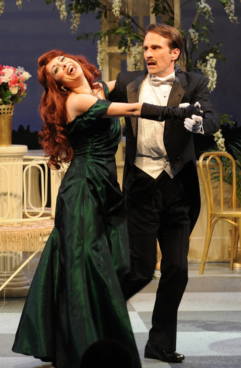 """Jessica John and Francis Gercke give it a whirl in Moonlight Stage Productions' """"Ring Round The Moon."""" Ken Jacques"""