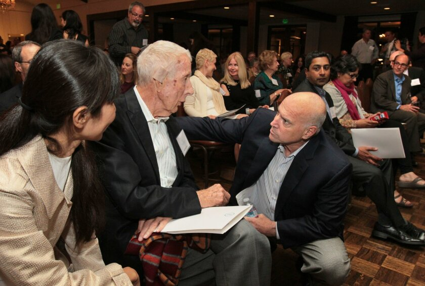 March 2, 2016, Rancho Santa Fe, California, USA_| Ralph Whitworth, at right, chats with fellow cancer patient Bill McComis, 89, left, prior to the beginning of the program at the Immunotherapy Foundation event at the Rancho Santa Fe Garden Club. |_Mandatory Photo Credit: Photo by Charlie Neuman/San