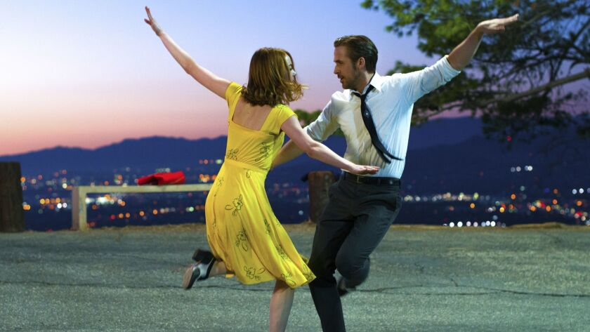 """FILE - This image released by Lionsgate shows Ryan Gosling, right, and Emma Stone in a scene from, """""""
