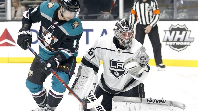 Los Angeles Kings goalie Jack Campbell (36) makes a save next to Anaheim Ducks forward Adam Henrique