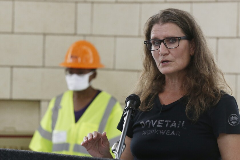 Kary Stackelbeck, State Archaeologist, speaks during a news conference as work continues on an excavation of a potential unmarked mass grave from the 1921 Tulsa Race Massacre, at Oaklawn Cemetery, in Tulsa, Okla., Friday, July 17, 2020. In 1921, white residents looted and burned Tulsa's black Greenwood district, killing as many as 300 people with many believed buried in mass graves. (AP Photo/Sue Ogrocki)
