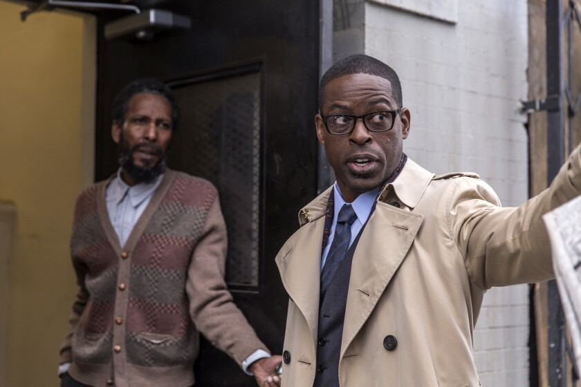 "Ron Cephas Jones, left, and Sterling K. Brown in the NBC series ""This Is Us."""