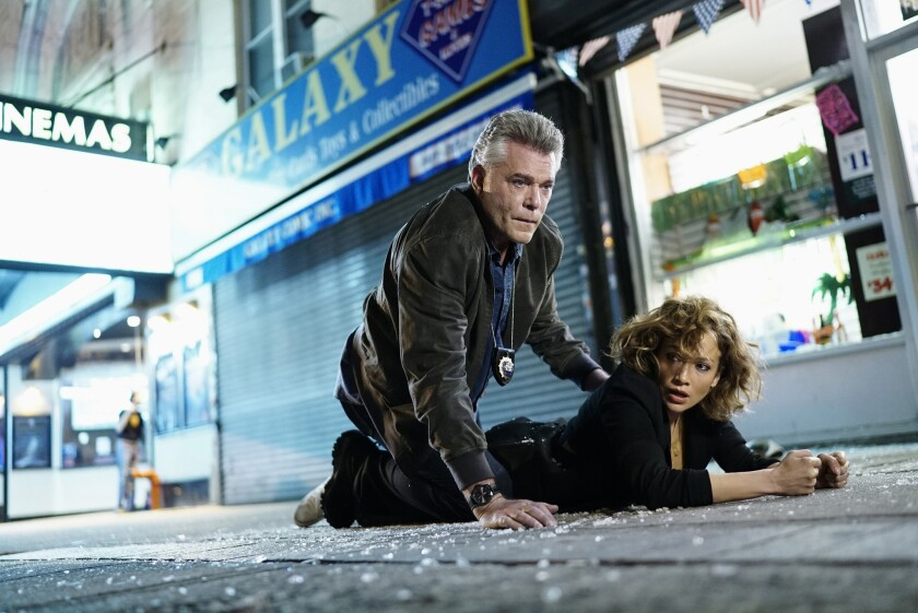 """Ray Liotta as Bill Wozniak, left, and Jennifer Lopez as Harlee Santos in a scene from """"Shades of Blue."""""""