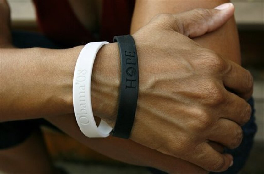 FILE - In this June 11, 2008, file photo, Rachel Lerman wears two bracelets supporting Sen. Barack Obama's candidacy for President, at her home in Washington. (AP Photo/Jacquelyn Martin, FILE)