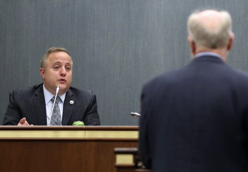 FILE - In this April 21, 2021, file photo, state Rep. Russell Fry, left, R-Surfside Beach, asks a question of South Carolina Senior Assistant Deputy Attorney General Don Zelenka during a hearing in Columbia, S.C. Fry is mounting a primary challenge to U.S. Rep. Tom Rice, saying the five-term Republican broke his constituents' trust by voting to impeach former President Donald Trump earlier this year. (AP Photo/Jeffrey Collins, File)