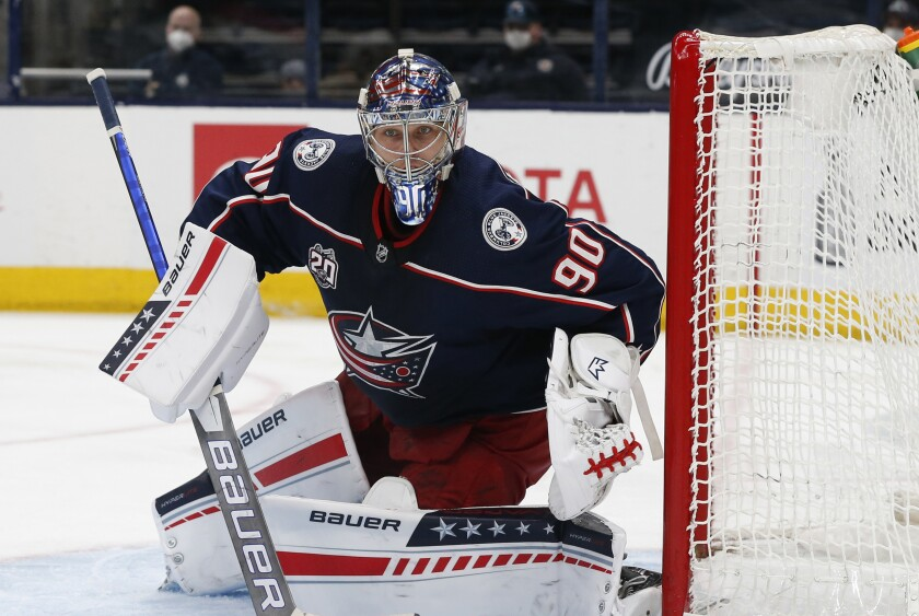 FILE - In this Wednesday, May 5, 2021 file photo, Columbus Blue Jackets' Elvis Merzlikins plays against the Nashville Predators during an NHL hockey game in Columbus, Ohio. The Columbus Blue Jackets signed goaltender Elvis Merzlikins to a five-year, $27 million contract extension, the team announced Tuesday, Sept. 21, 2021. (AP Photo/Jay LaPrete, File)