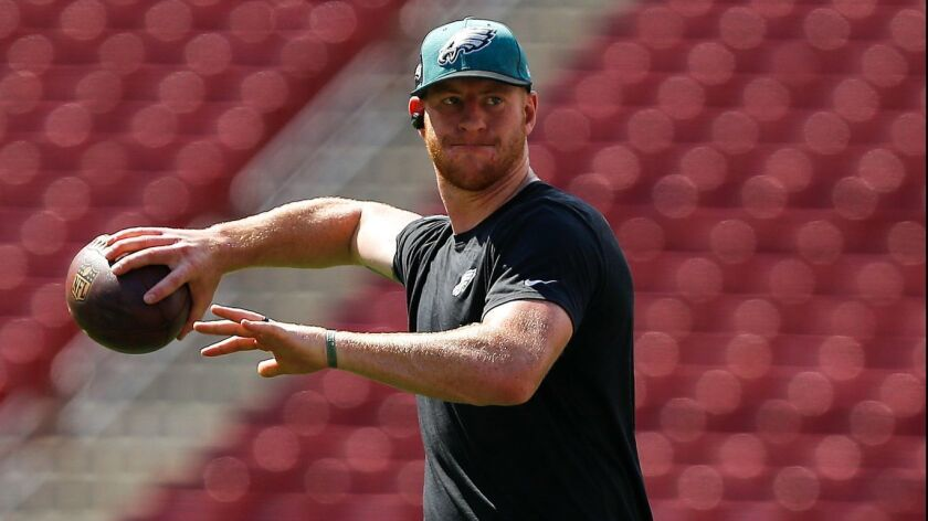 Carson Wentz throws before the Eagles game Sunday in Tampa Bay.