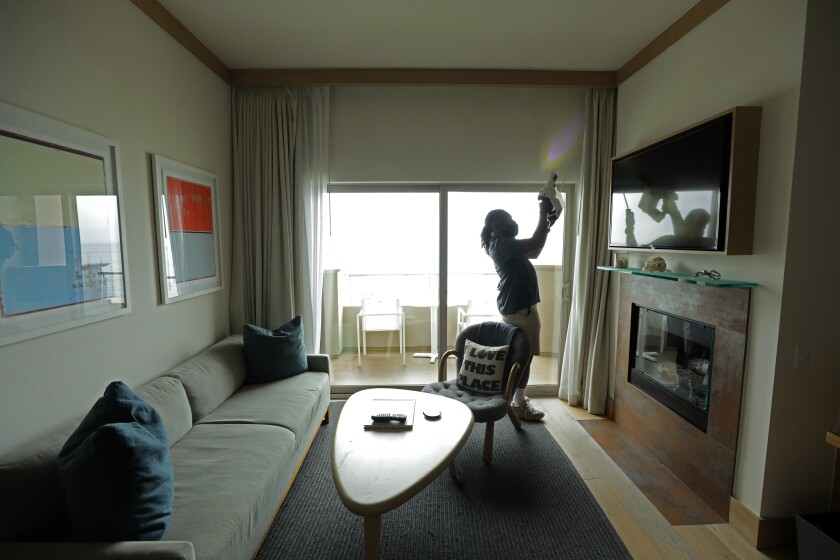 A guest room at the Malibu Beach Inn Hotel & Spa is disinfected.
