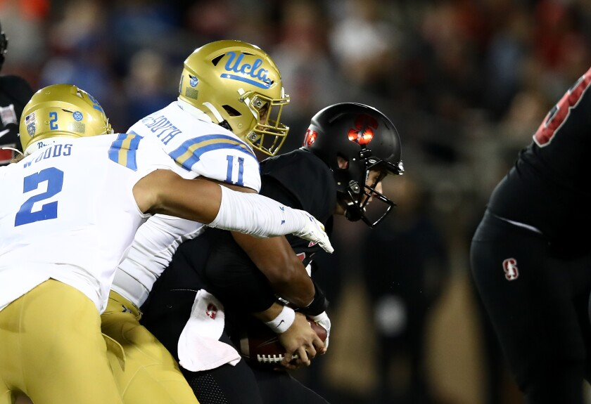UCLA's Keisean Lucier-South (11) sacks Stanford's Jack West (10) at Stanford Stadium on Thursday in Palo Alto.