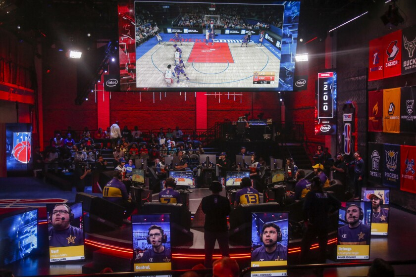 Members of the Lakers Gaming team play against Kicks Gaming in the NBA 2K League Studio on Wednesday