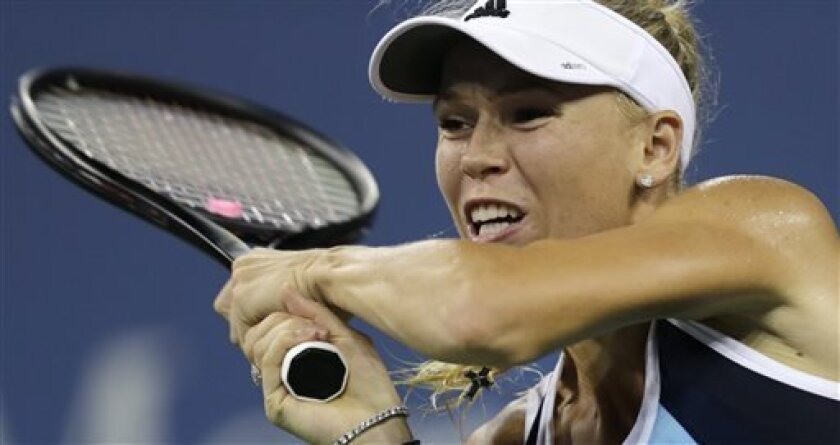 Caroline Wozniacki, of Denmark, returns against Camila Giorgi, of Italy, during the third round of the 2013 U.S. Open tennis tournament, Saturday, Aug. 31, 2013, in New York. (AP Photo/Charles Krupa)