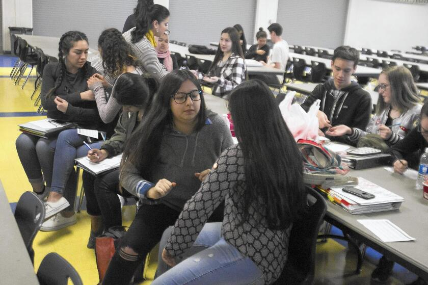 Students from Fountain Valley High School share pins in support of Human Options during a workshop Wednesday intended to get students talking about relationships, types of abuse and other topics.