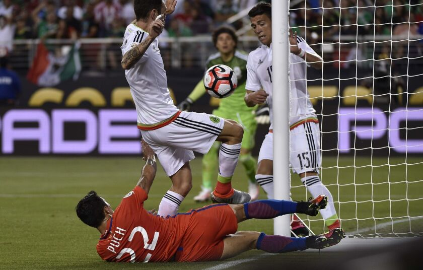 Mexico's Hector Moreno (R) and Chile's Edson Puch vie for the ball during the Copa America Centenario quarterfinal football match in Santa Clara, California, United States, on June 18, 2016. / AFP PHOTO / OMAR TORRESOMAR TORRES/AFP/Getty Images ** OUTS - ELSENT, FPG, CM - OUTS * NM, PH, VA if sourced by CT, LA or MoD **