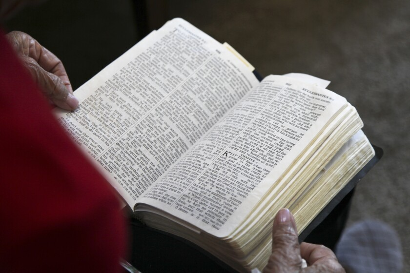 A woman reads from her Bible.