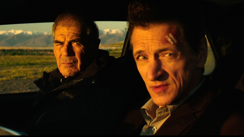 "John Hawkes, right, is a disgraced ex-cop trying to solve a slaying, and Robert Forster is the vengeful grandfather of the victim in the engaging ""Small Town Crime."""