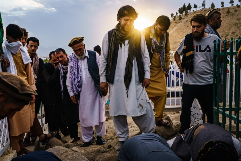 Ajmal Ahmadi grieves for his family, all 10 civilians that were killed in a U.S. drone airstrike, in Kabul, Afghanistan