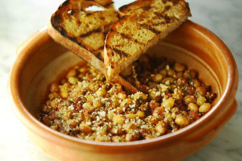 Beans and harissa by chef Vince Schofield of Catania Coastal Italian in La Jolla.