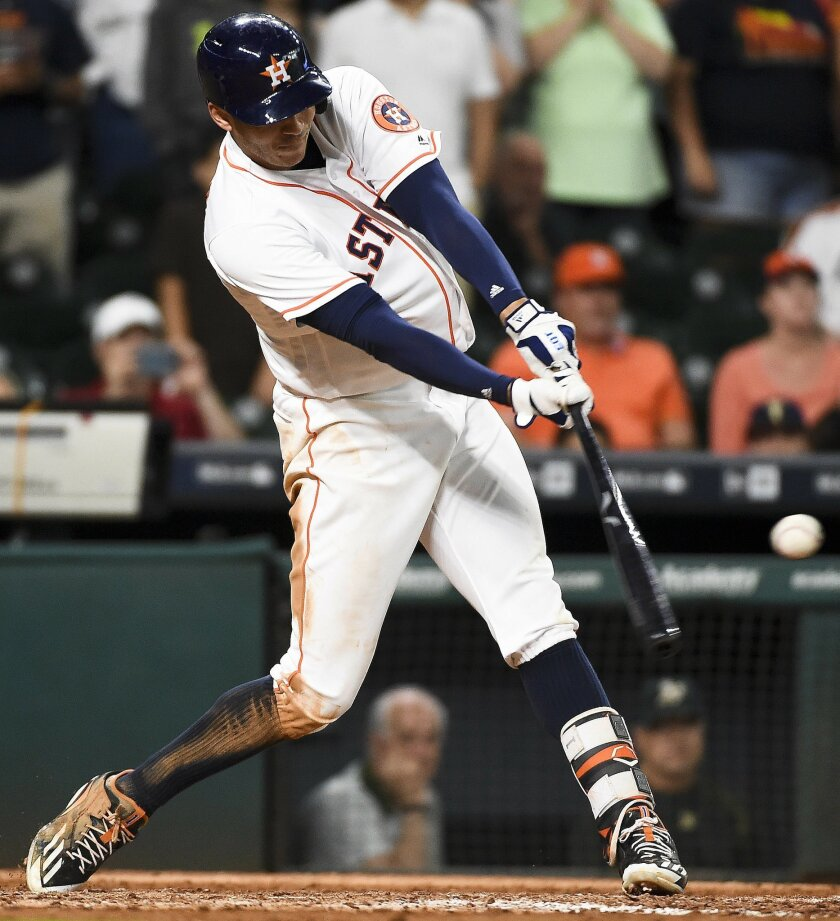 Houston Astros' Carlos Correa hits the game-winning RBI single during the 12th inning of a baseball game against the Oakland Athletics, Saturday, June 4, 2016, in Houston. Houston won 6-5. (AP Photo/Eric Christian Smith)