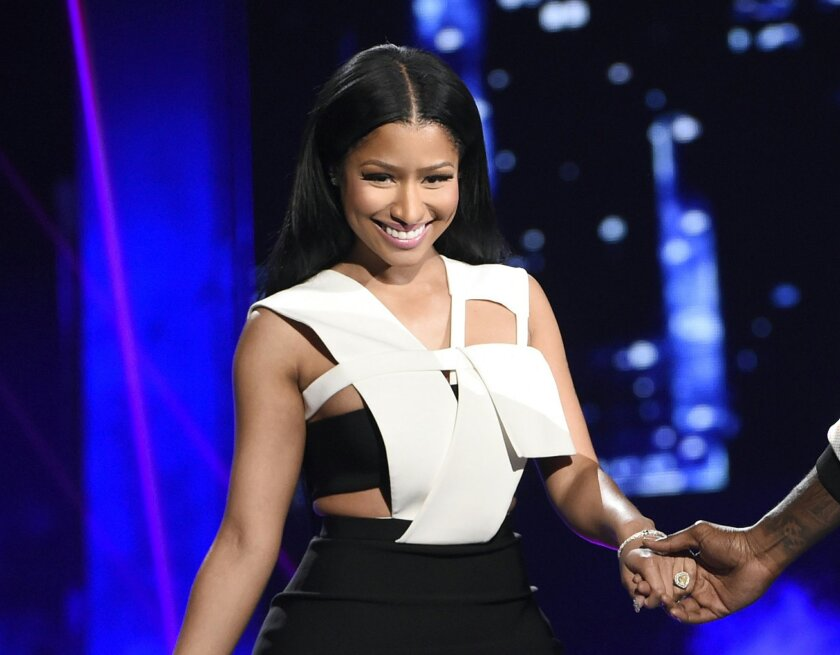 """FILE - In this June 28, 2015 file photo, Nicki Minaj appears at the BET Awards in Los Angeles. Taylor Swift apologized to Minaj Thursday, July 23, on Twitter after the pair traded words Tuesday after MTV announced the nominees for the VMAs, where Swift is the leader with nine. Minaj was upset she didn't earn a nomination for video of the year for """"Anaconda"""" and launched a series of tweets about how slim women earn top nominations. (Photo by Chris Pizzello/Invision/AP, File)"""