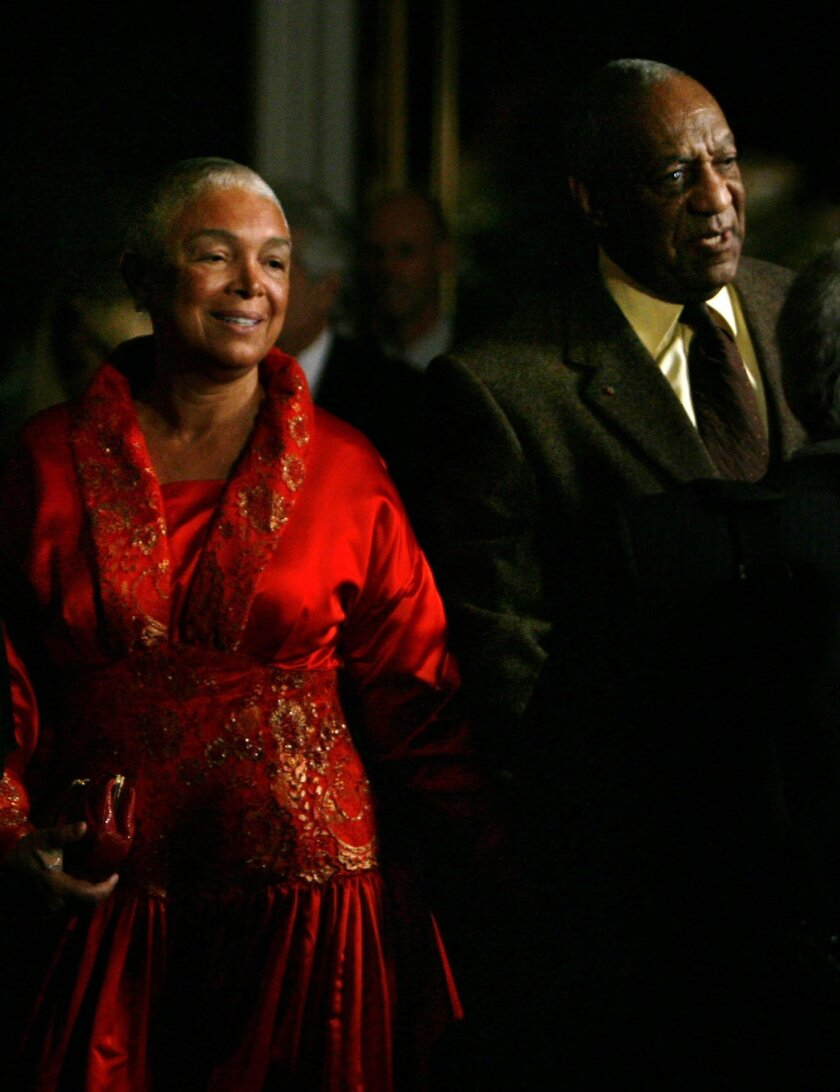 File- This Oct.26, 2009, file photo shows comedian Bill Cosby entering the Kennedy Center with his wife Camille in Washington. A federal judge in Massachusetts has ruled that Cosby's wife must answer questions under oath in a defamation lawsuit filed by seven women who claim Cosby sexually assaulte