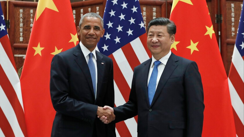 Chinese President Xi Jinping greets President Barack Obama before their meeting in Hangzhou.