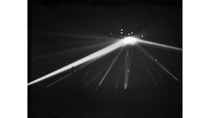 Searchlights converge on an unidentified object over Los Angeles in the early morning hours of Feb. 25, 1942. This is the unretouched version of this photo; a retouched photo ran in the Los Angeles Times the next day.