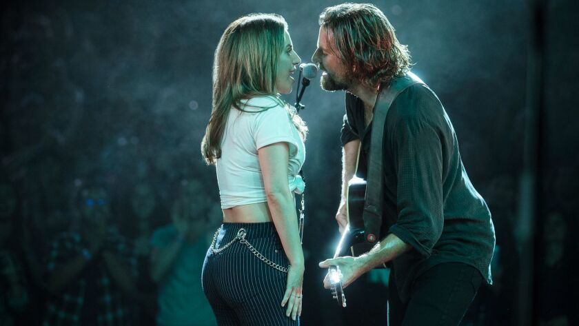"(L-R) - Bradley Cooper and Lady Gaga in a scene from the movie ""A Star is Born."" Credit: Clay Enos/W"