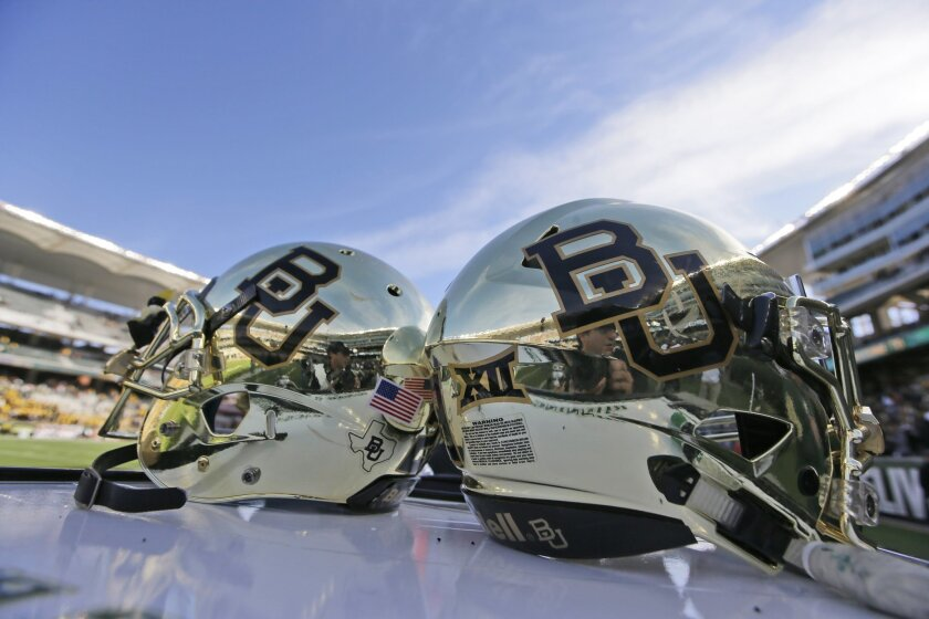 FILE - In this Dec. 5, 2015, file photo, Baylor helmets on shown the field after an NCAA college football game in Waco, Texas. Baylor University will look to rebuild its reputation and perhaps its football program after an outside review found administrators mishandled allegations of sexual assault