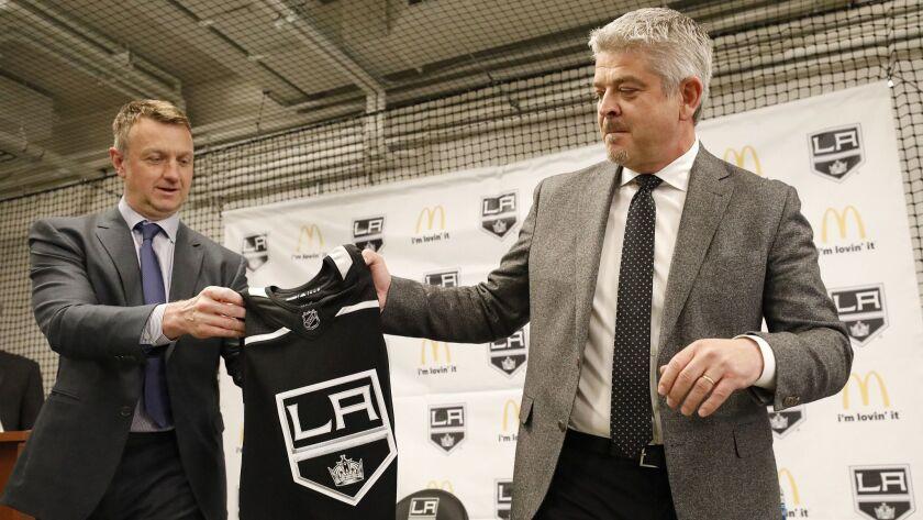 EL SEGUNDO, CA - APRIL 17, 2019 - LA Kings General Manager Rob Blake, left, presents a personalized