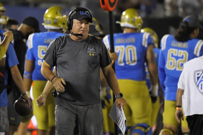 UCLA coach Chip Kelly stands on the sideline.