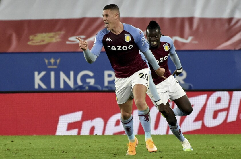 Aston Villa's Ross Barkley celebrates after scoring during the English Premier League soccer match between Leicester City and Aston Villa at the King Power Stadium in Leicester, England, Sunday, Oct. 18, 2020. (AP Photo/Rui Vieira, Pool)