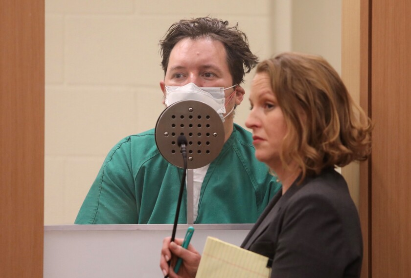 Jon David Guerrero, in San Diego Superior Court on Monday wearing a medical mask because of an illness, pleaded guilty to a string of 2016 attacks, mostly on homeless men. Three men and one woman died. Defense attorney Whitney Antrim stands near him.