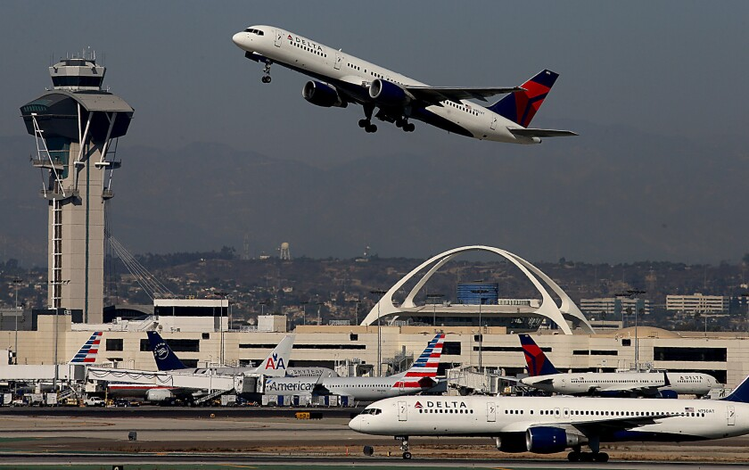 A jetliner takes off from Los Angeles International Airport, where record numbers of laser strikes on aircraft have been reported. The FBI today announced $10,000 rewards for information leading to arrests in those incidents.