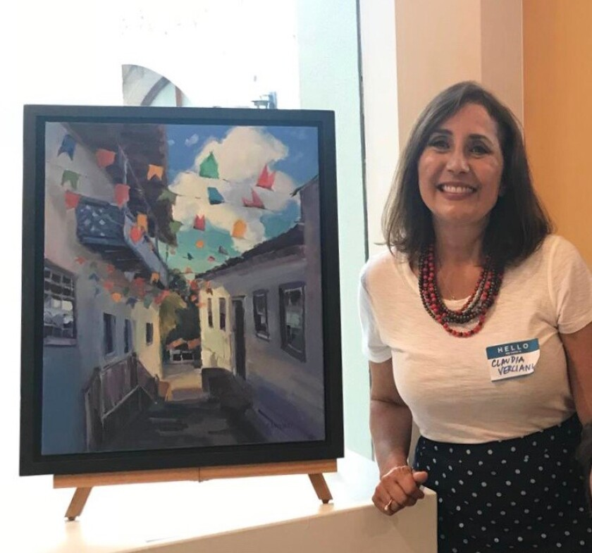 Artist Claudia Verciani with one of her pieces of artwork.